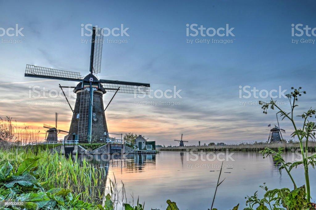 Kinderdijk canal and windmills stock photo