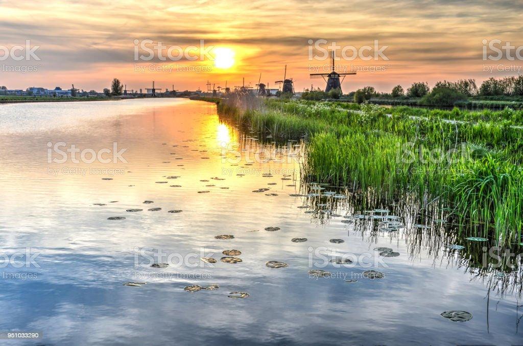 Kinderdijk canal at sunset stock photo