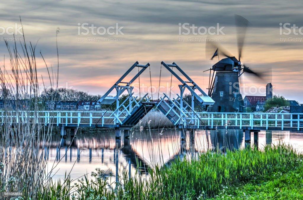 Kinderdijk windmill and drawbridge stock photo