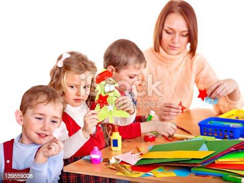544351868 istock photo Kindergarden teacher with children. 139559008