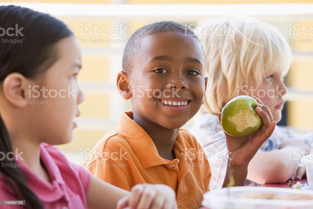 Kindergarten children eating lunch royalty-free stock photo