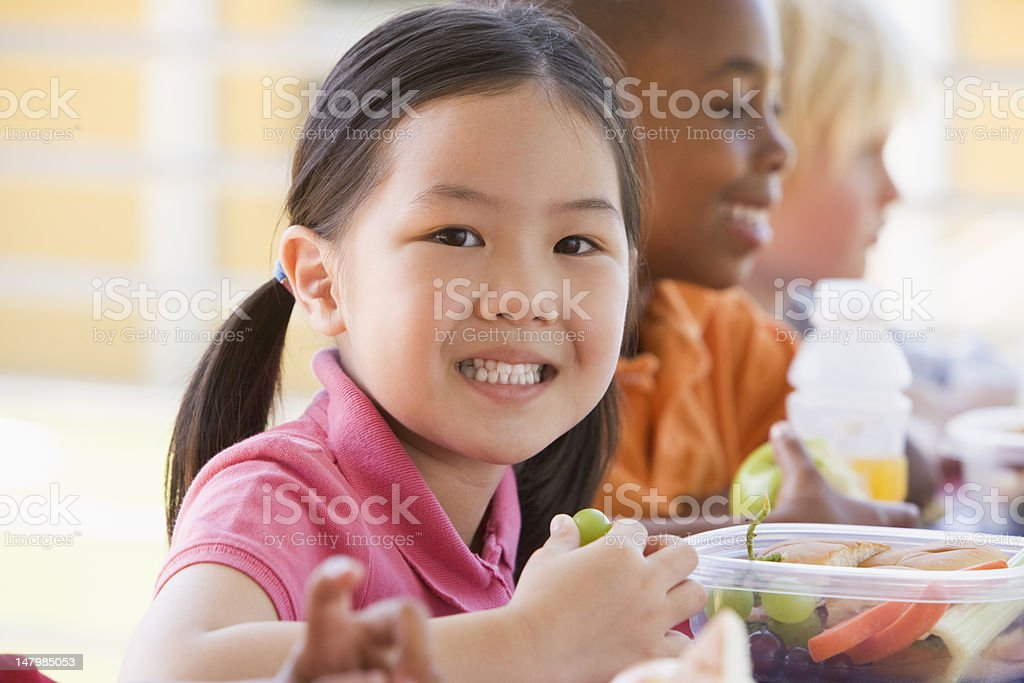 Kindergarten children eating lunch royalty-free stock photo
