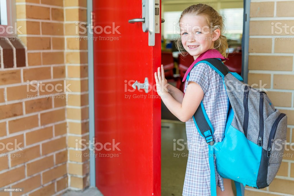 Kindergarten Primary School Girl Student Arriving for Class stock photo