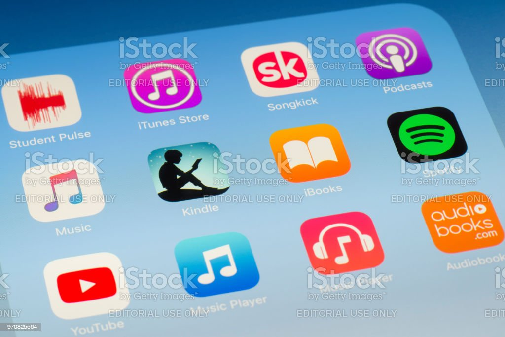 Kindle, iBooks and other streaming Apps on iPad screen stock photo