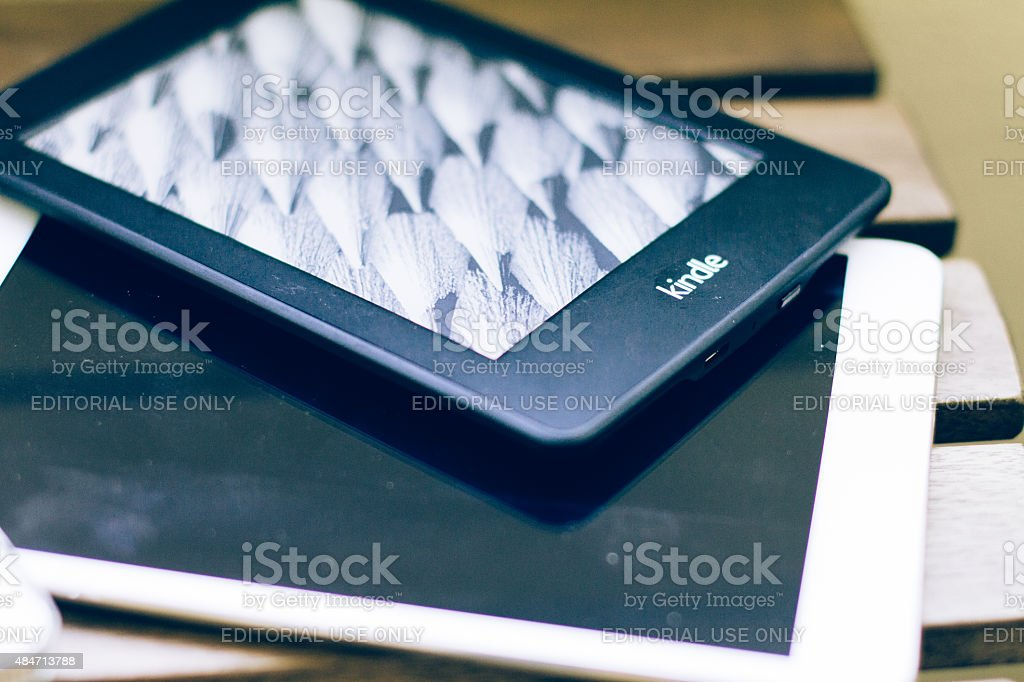 Kindle Paperwhite and iPad mini stock photo