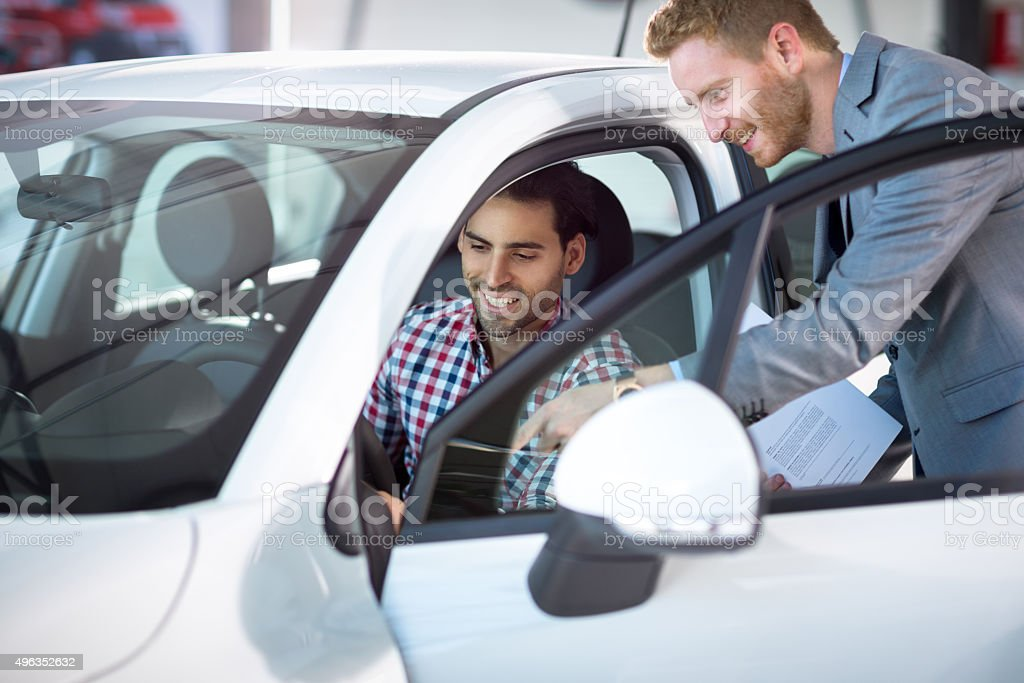Kindly car manager with customer stock photo