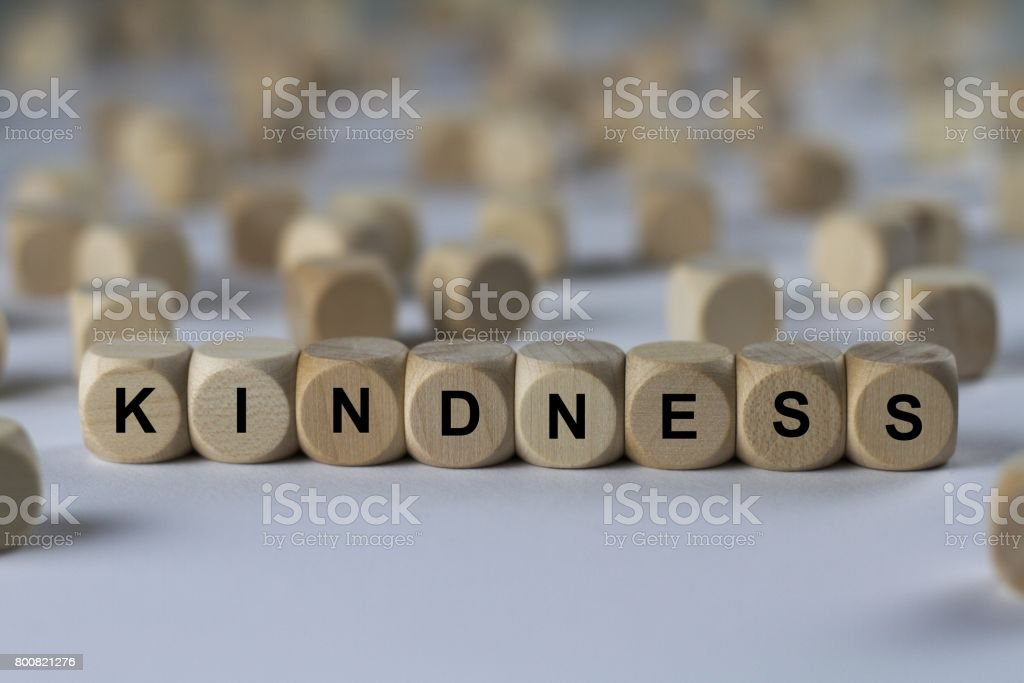 kindness - cube with letters, sign with wooden cubes stock photo