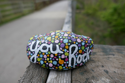Kindness rock with painted you rock message and colorful polka dots