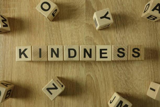 vänlighet ord från träklossar - omsorg bildbanksfoton och bilder