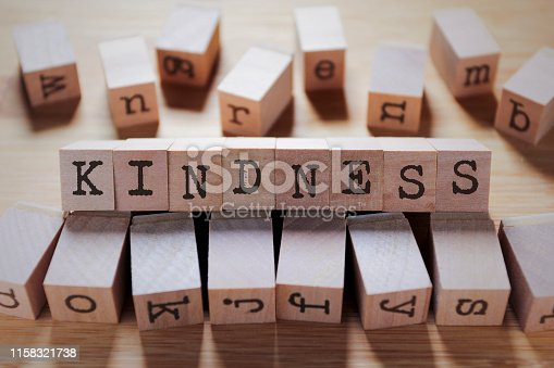 istock Kindness Word In Wooden Cube 1158321738