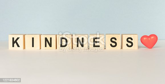 istock Kindness Word Written In Wooden Cube on a light background 1221634802