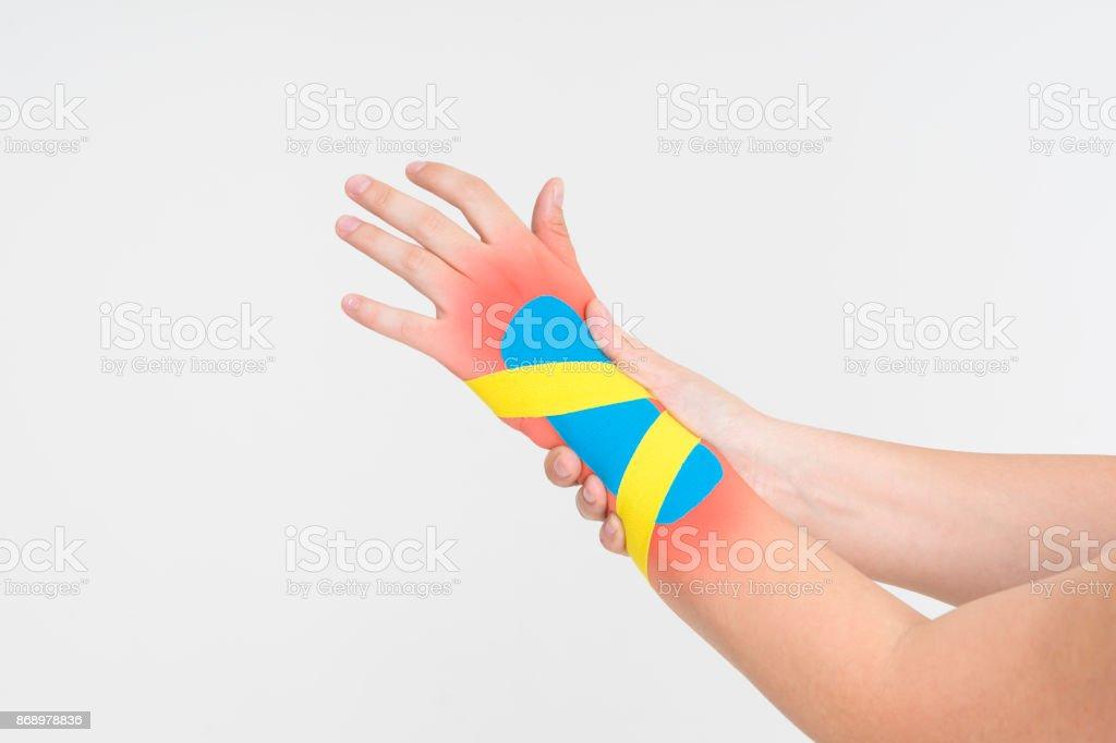 Kinesio tape, kinesiology taping on human hand stock photo