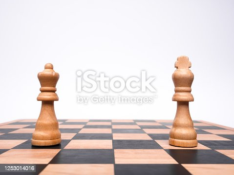 A king and queen separated on a chess board to represent a couple social distancing
