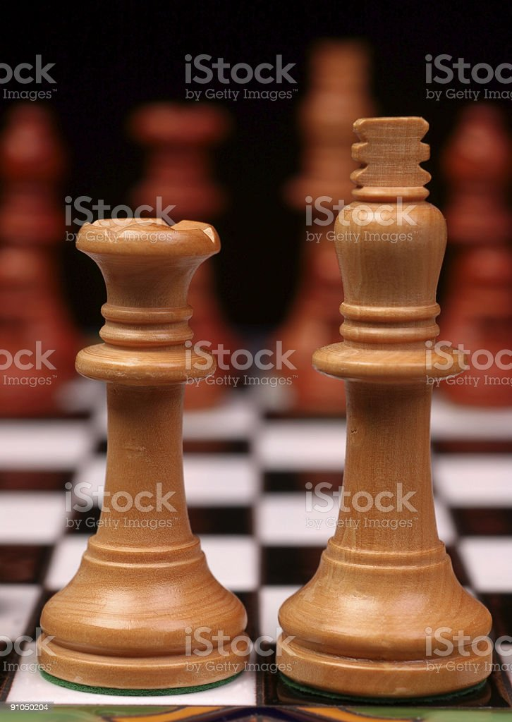 King and Queen on Chess Board royalty-free stock photo