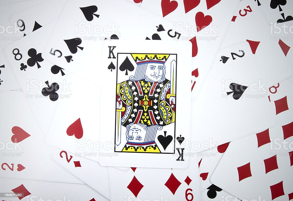 King card with playing cards background royalty-free stock photo
