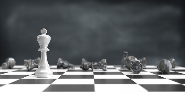 Business strategy, winning, teamwork and competition concept. 3d rendered white King chess piece standing alone on chess board. Dark atmosphere and large copy space.