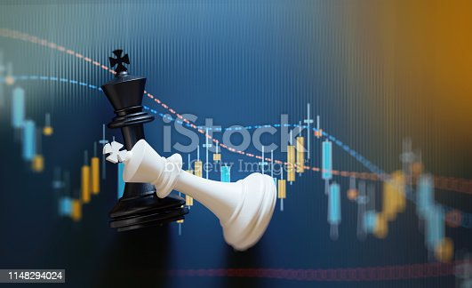 King chess pieces on financial data analysis graph. Selective focus. Horizontal composition with copy space.