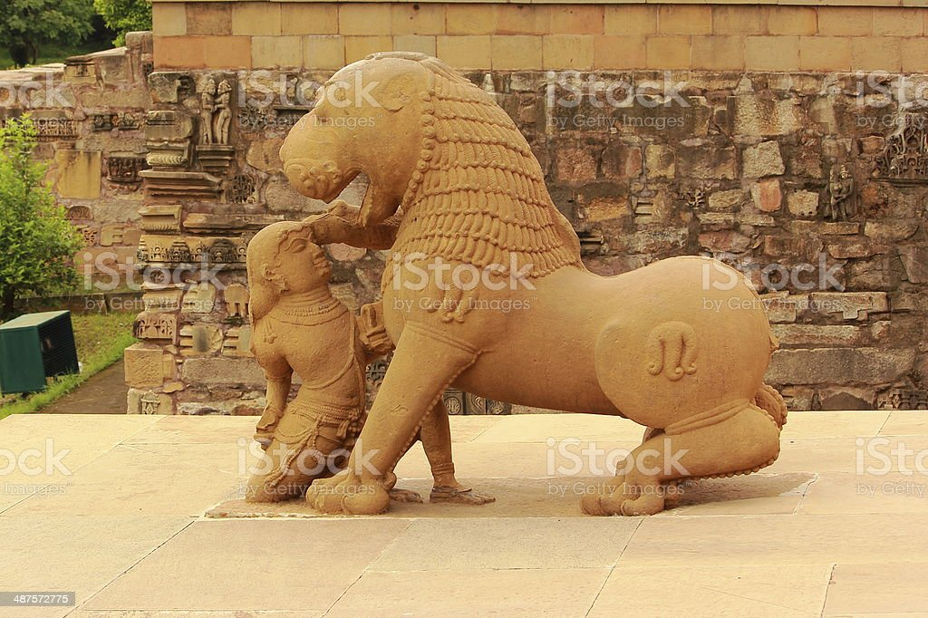 King fighting with a lion sculpture in Khajuraho stock photo