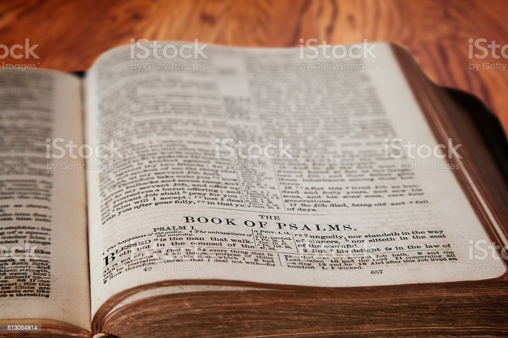 King James Bible Book of Psalms on Rustic Wooden Background stock photo