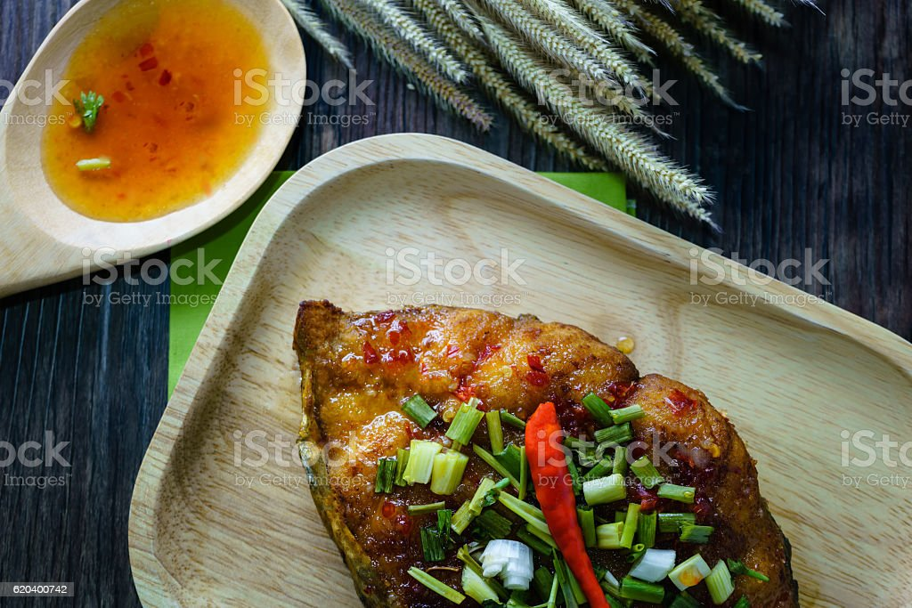 King Mackerel serve with sauce in Thai menu food stock photo