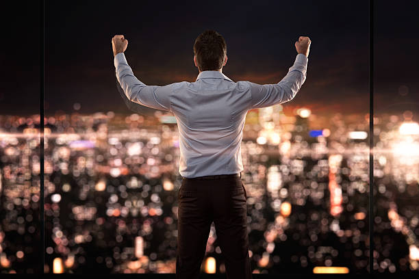 King of the world Young successful businessman standing in front of the city passion stock pictures, royalty-free photos & images
