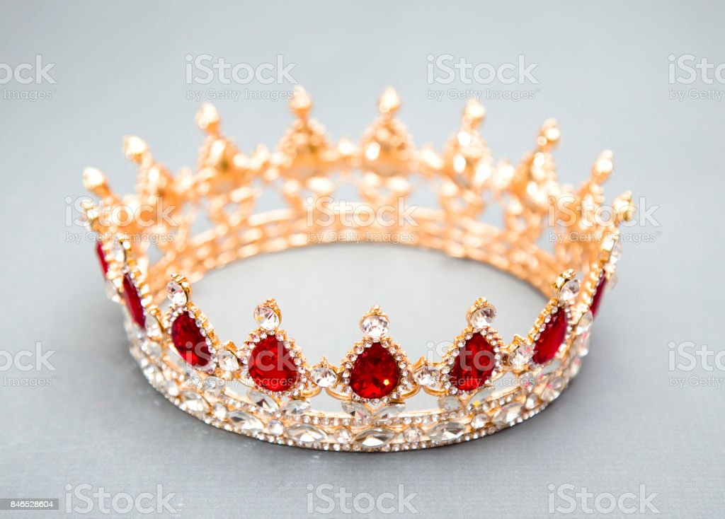 A King or a Queen's Crown on a Grey Background stock photo