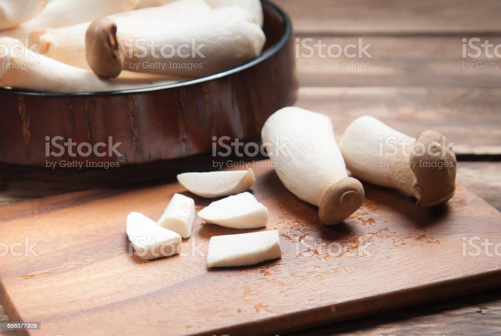 King Oyster mushroom (Eringi) on wood backgroud. stock photo