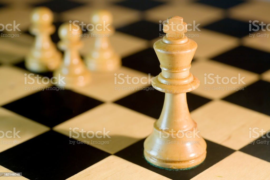 King & Pawns on Chessboard royalty-free stock photo