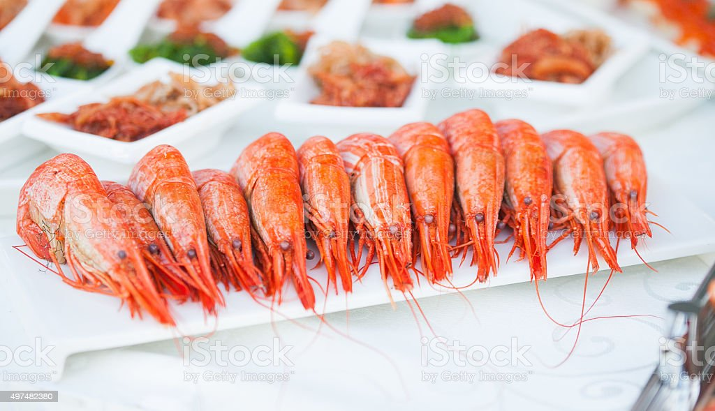 King prawns on a banquet. Starters table stock photo