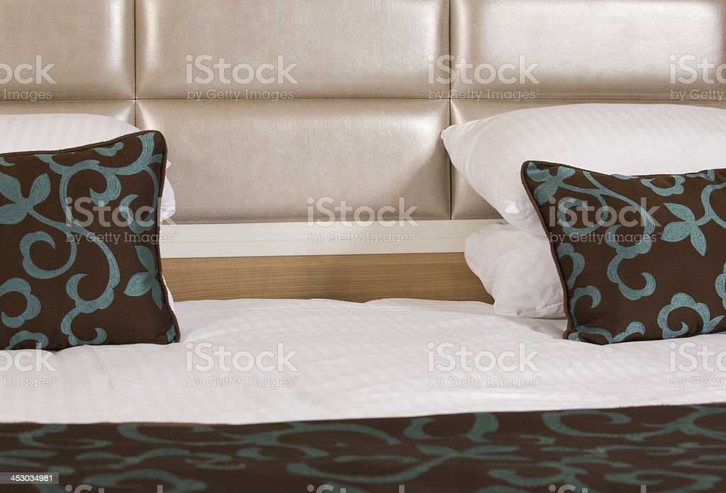 King sized bed in a luxury hotel room royalty-free stock photo