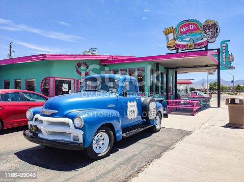 Kingman, Arizona, USA. May 26, 2019. Mr Dz Route 66 Diner, Blue collectible vintage car outside of the restaurant. Blue sky background.
