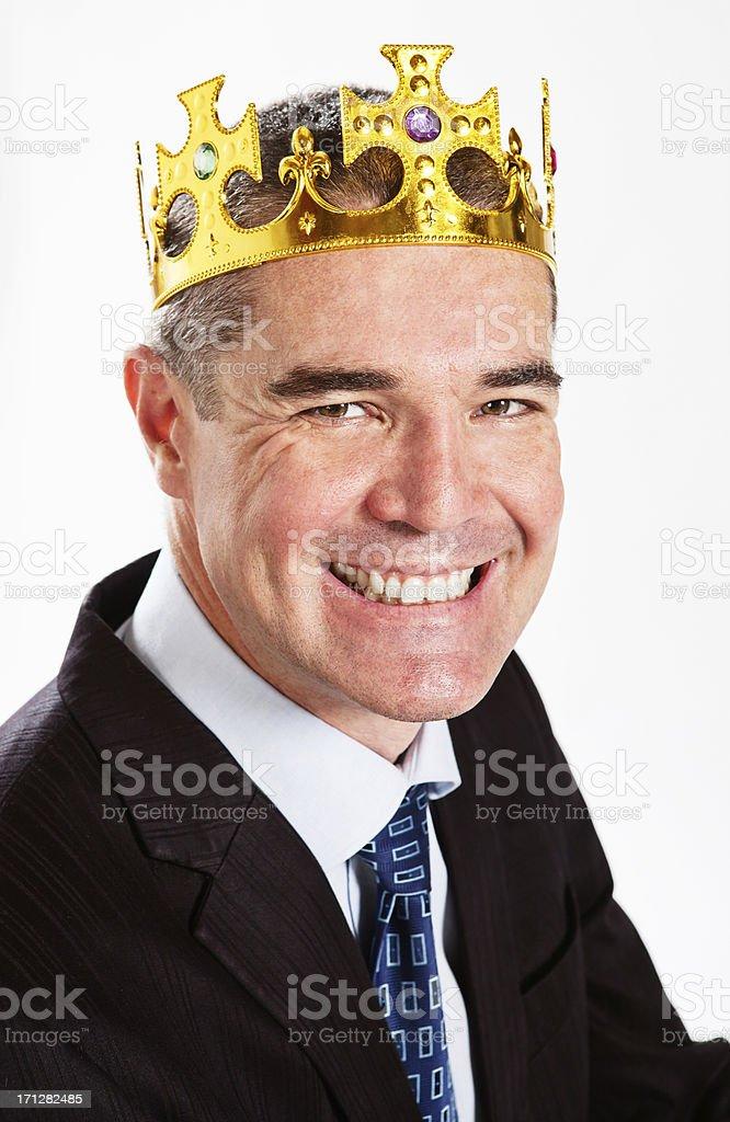 Kingpin! Smiling businessman wearing golden crown stock photo