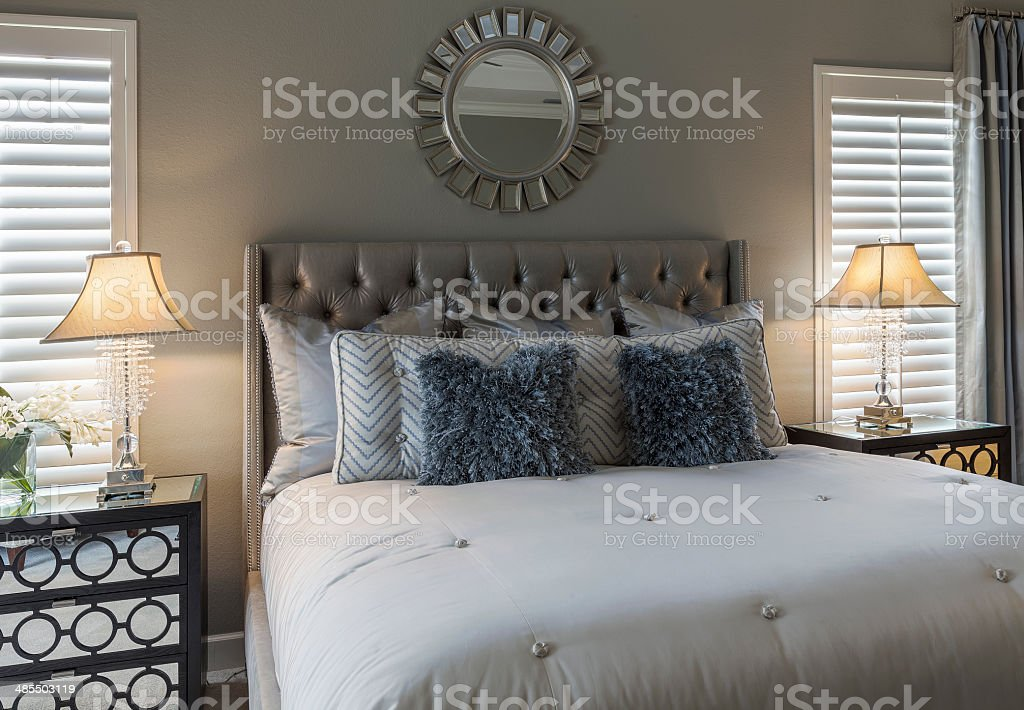 King-size Bed in Master Bedroom of Upscale Home stock photo