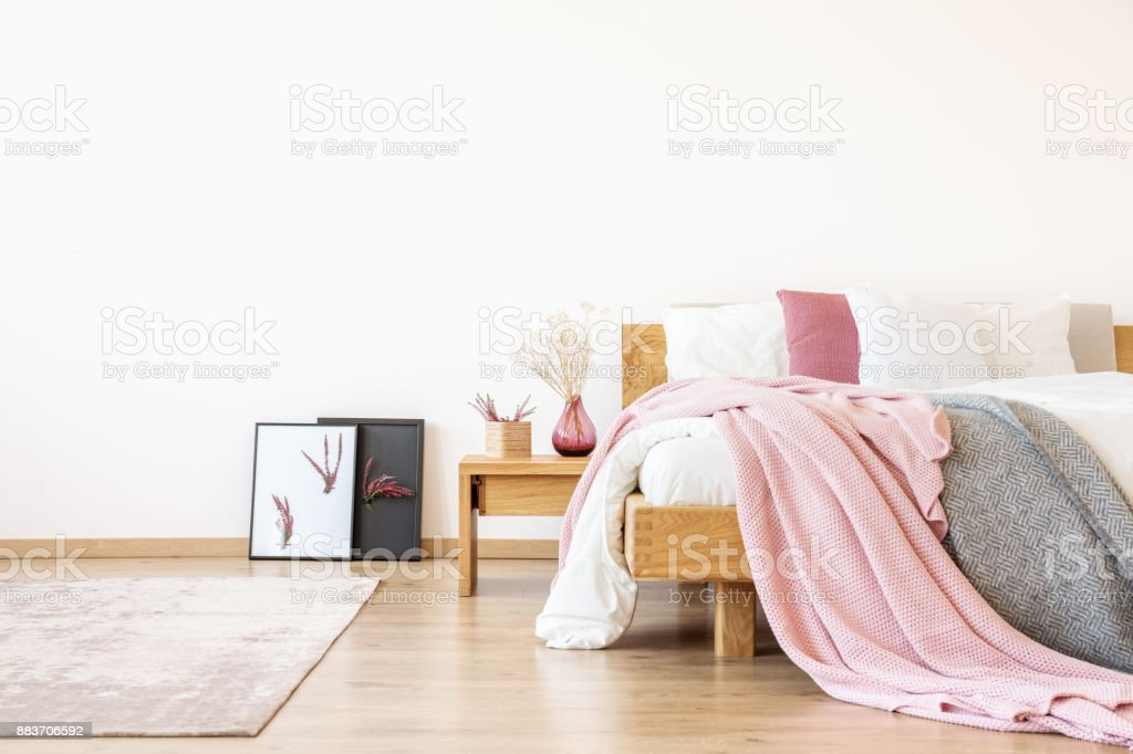 King-size bed in white bedroom stock photo