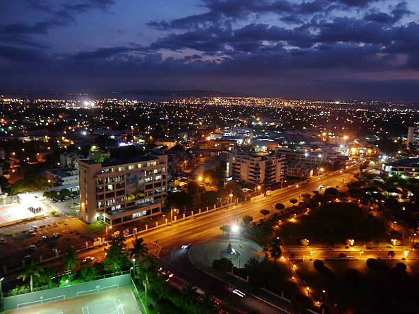 kingston night lights - jamaica stock photos and pictures