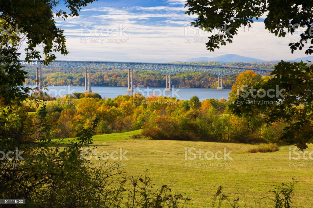 Kingston–Rhinecliff Bridge over Hudson River, Trees in Fall Colors (Foliage) and Blue Sky as seen from Poets' Walk, Red Hook, Hudson Valley, New York. stock photo