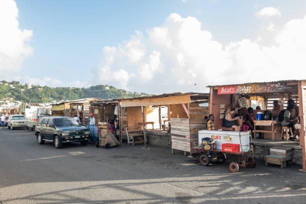 kingstown, saint vincent and the grenadines - kleine bars in der uferstraße - kingstown stock-fotos und bilder