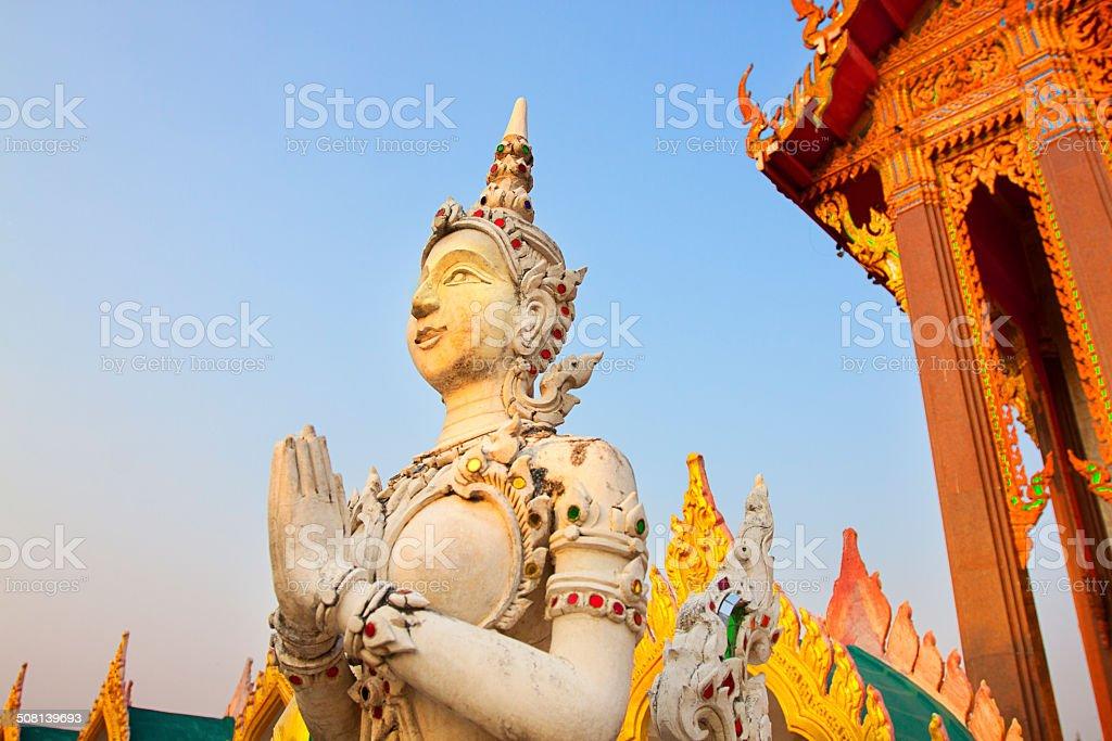 Kinnari statue at the Temple demonstrating sawadee action, Bangkok, Thailand stock photo