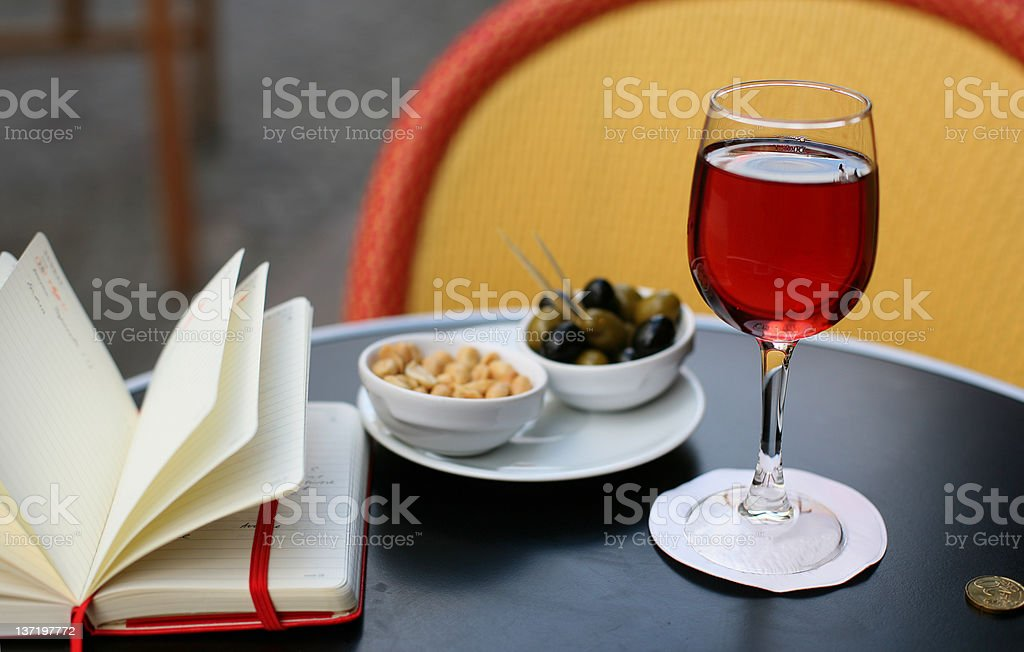 Kir cassis, nibbles and personal organizer royalty-free stock photo