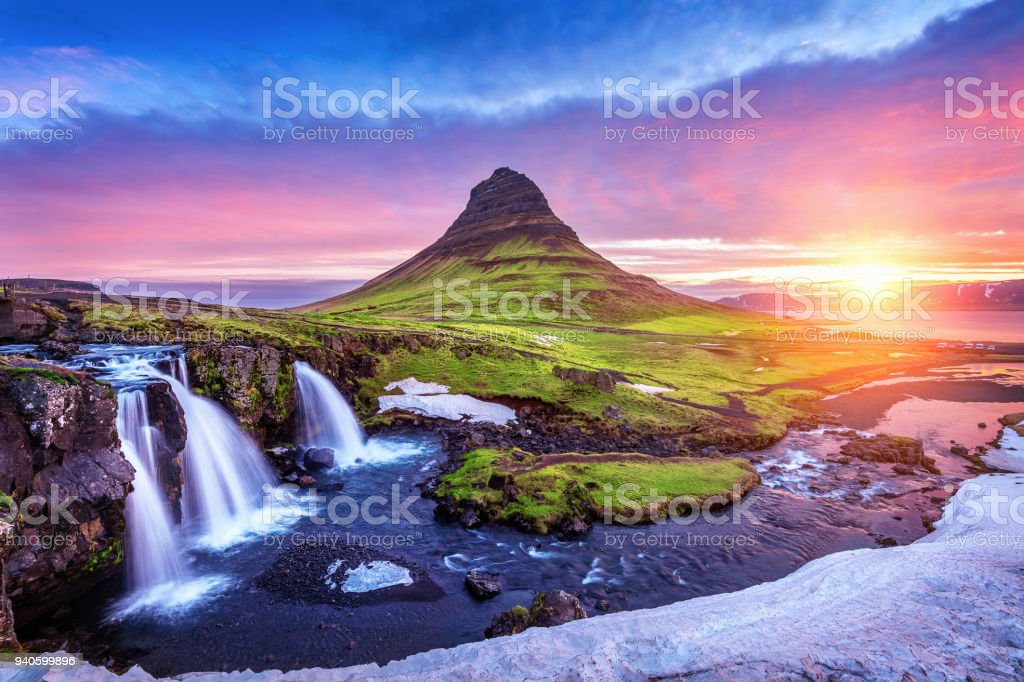 Kirkjufell at sunrise in Iceland. Beautiful landscape and sunrise. stock photo