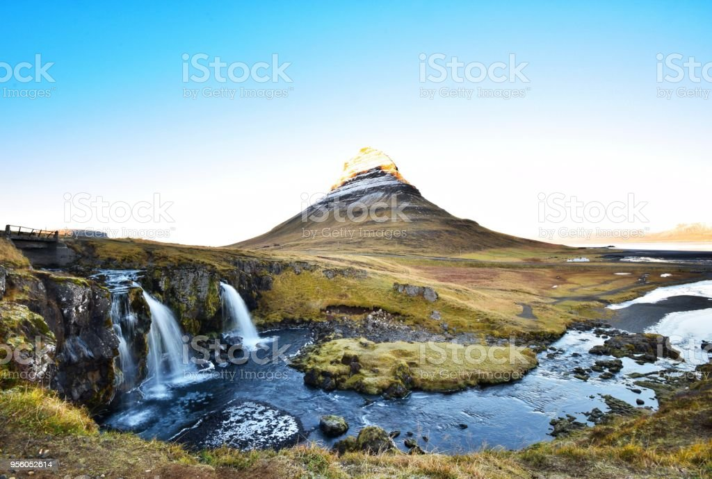 Kirkjufell, the famous mountain with perfect landscape of waterfall and river in front. stock photo
