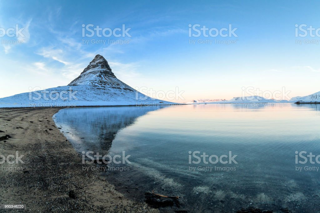 Kirkjufell view during winter snow which is a high mountain on the north coast of Iceland stock photo