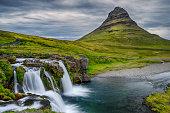 Kirkjufell is a spectacular mountain near the town Grundarfjörður at Snæfellsnes Peninsula.