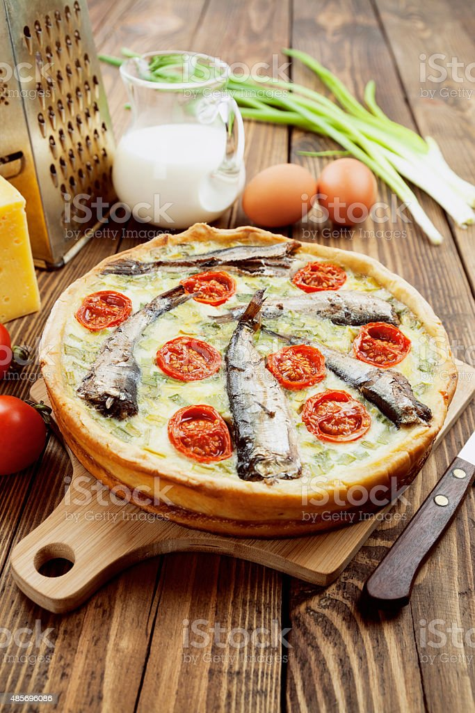 Kish with sprats and cherry tomatoes stock photo
