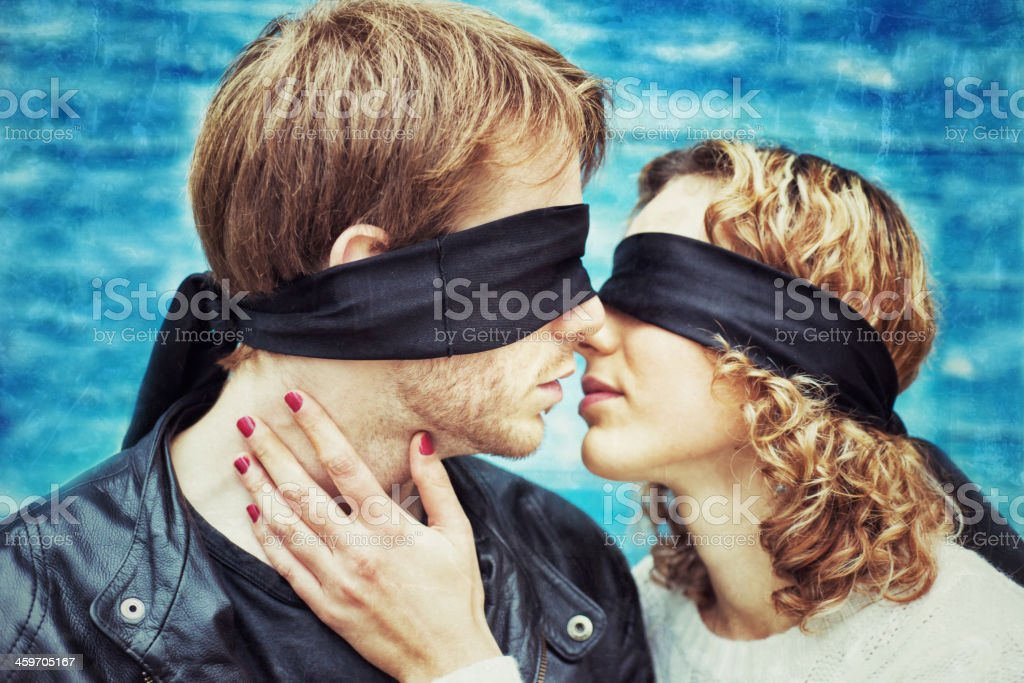 Kiss. Blindfolded Young Couple is kissing stock photo