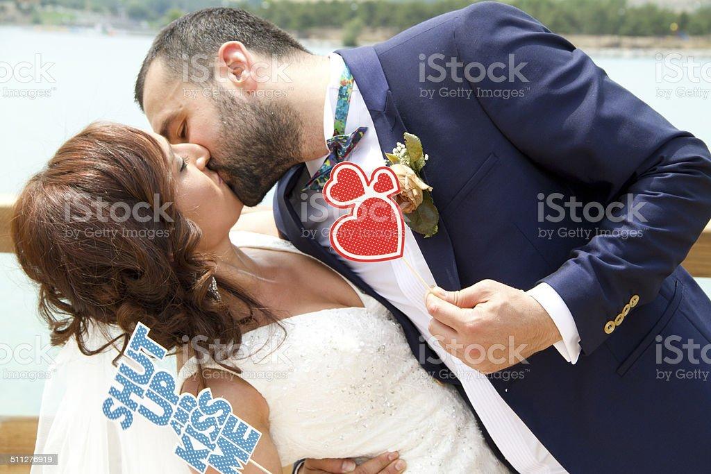 Kiss - Bride and groom stock photo