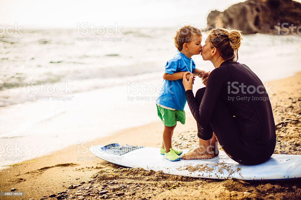 Kiss for my little surfer stock photo
