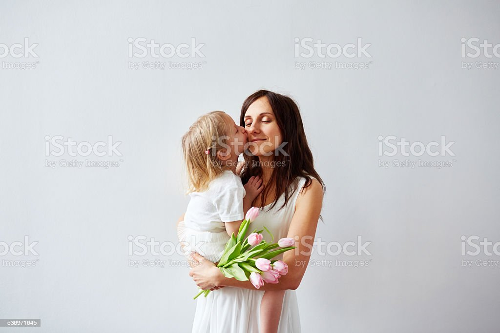 Kiss from daughter stock photo