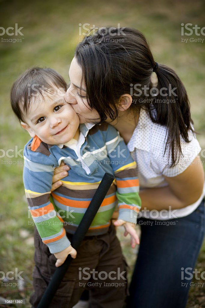 Kiss from mom royalty-free stock photo