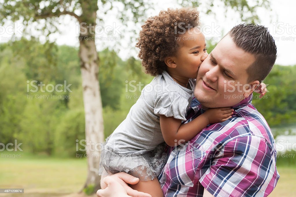 Kiss from the girl to her dad stock photo